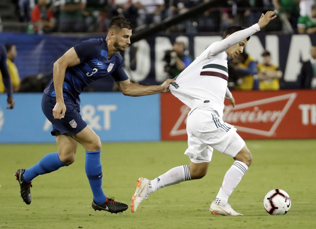 United States defenseman Matt Miazga (3) grabs the jersey of Mexico forward Angel Zaldivar, right, during an international friendly match Tuesday, Sep