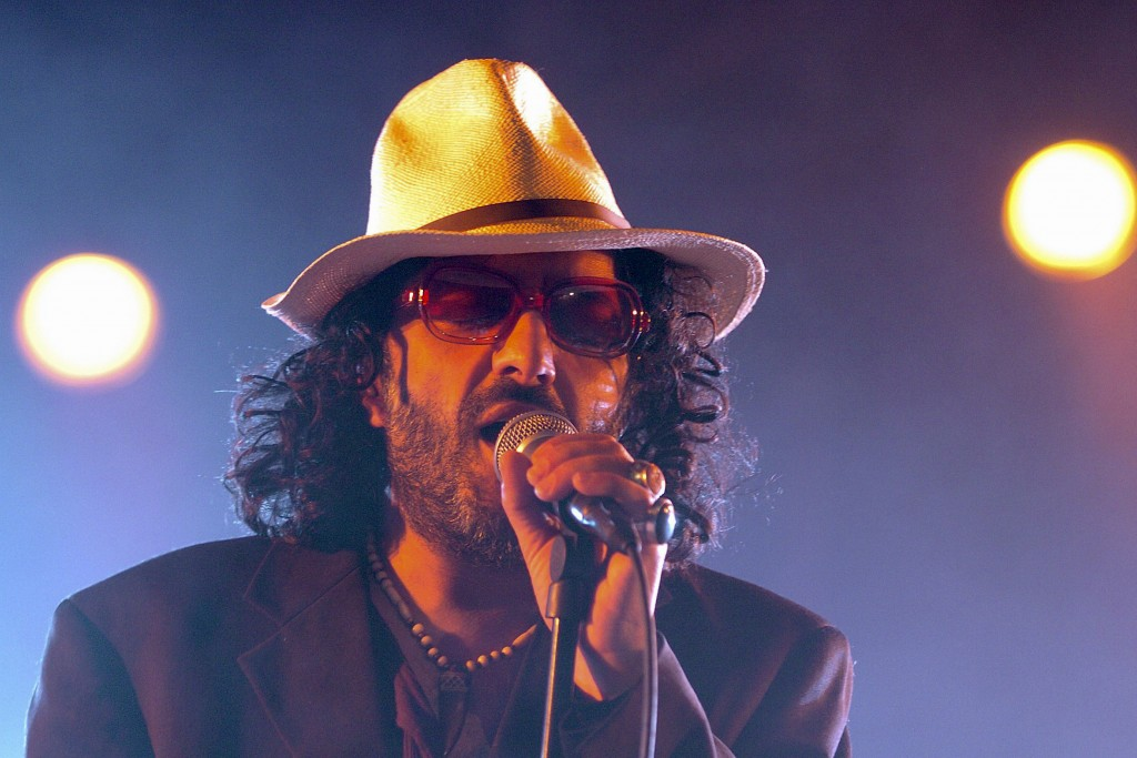 FILE - In this July 19, 2005 file photo, Algerian singer Rachid Taha sings on the main stage during the opening day of the Paleo Festival in Nyon, Swi