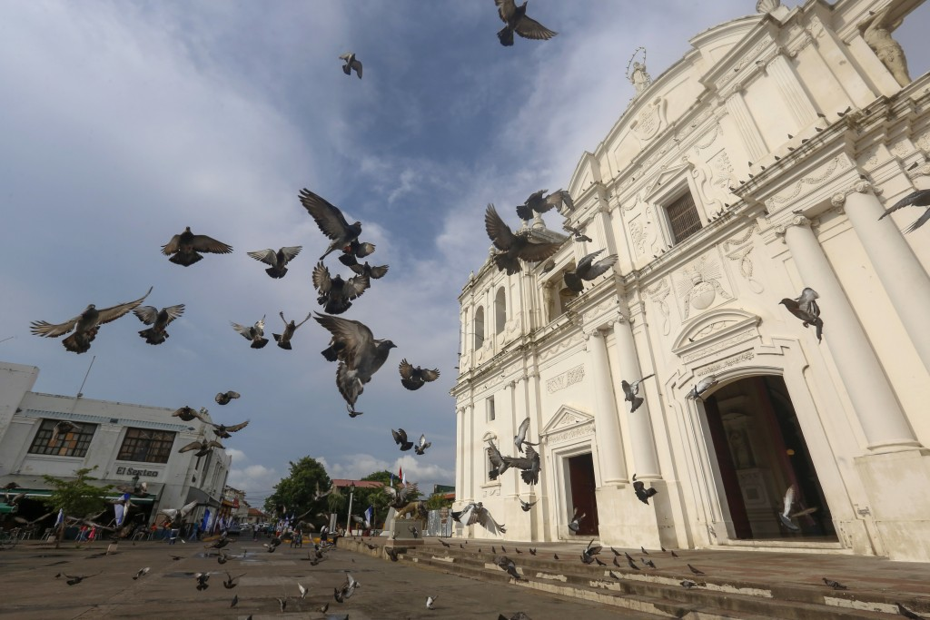 Doves fly in front of Leon Cathedral in Leon, Nicaragua, Tuesday, Sept. 11, 2018. Protests against the administration of President Daniel Ortega start