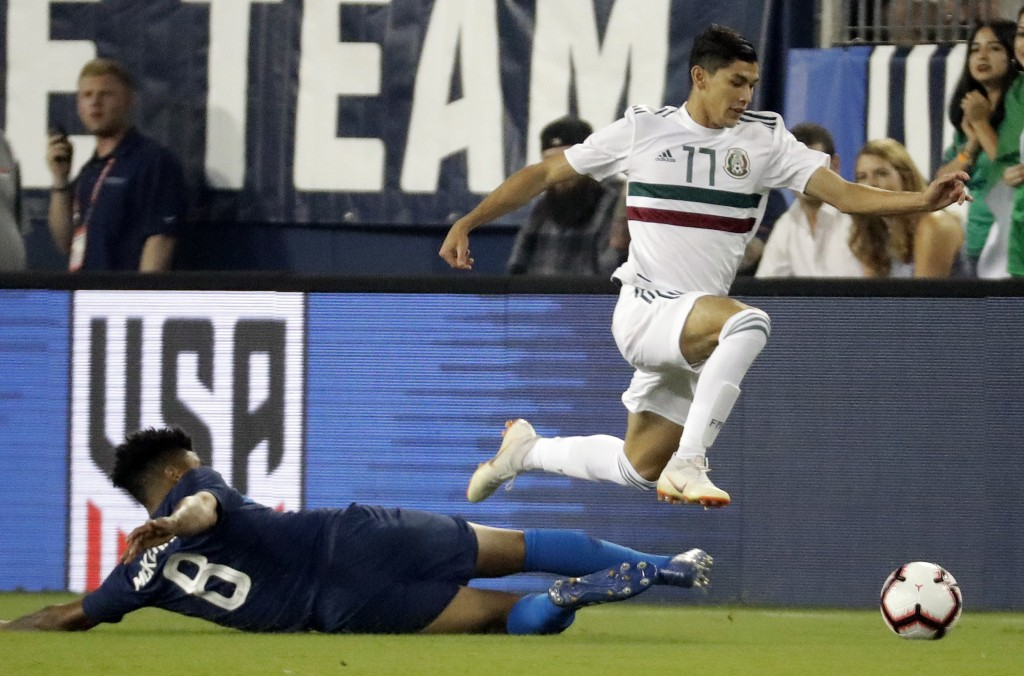 Mexico midfielder Elias Hernandez (11) moves the ball past U.S. midfielder Weston McKennie (8) during an international friendly match Tuesday, Sept. 1