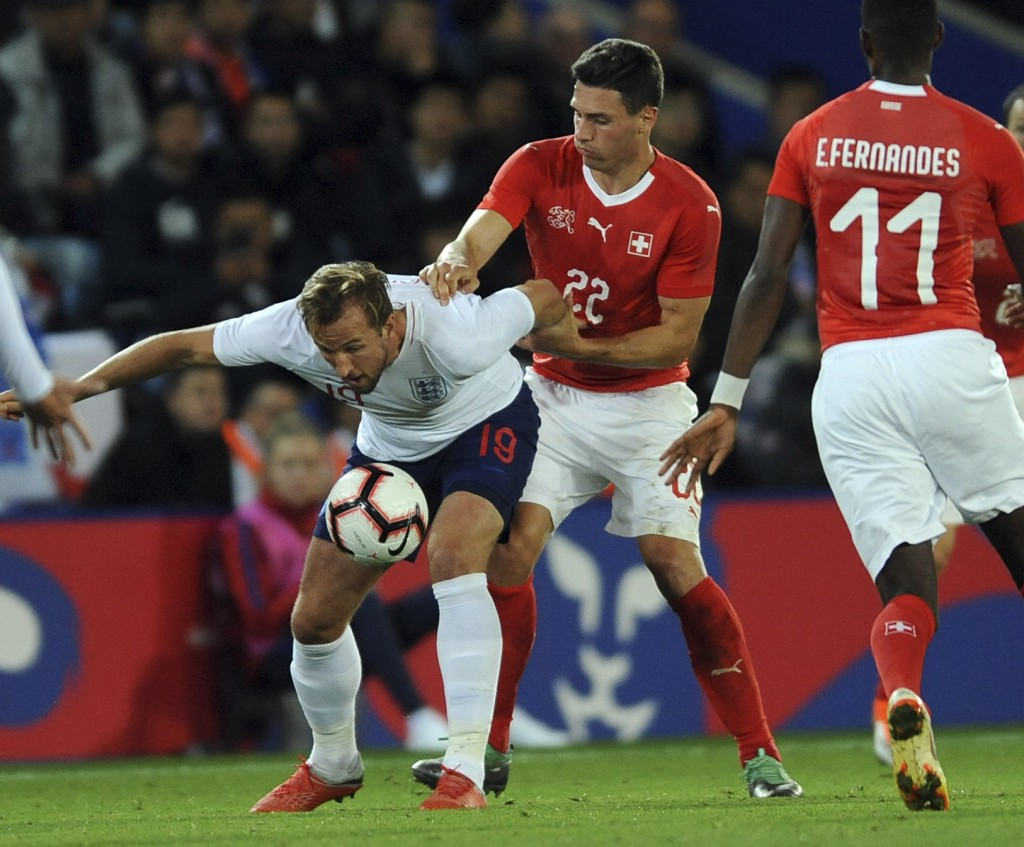 England's Harry Kane, left, and Switzerland's Fabian Schaer challenge for the ball during the International friendly soccer match between England and