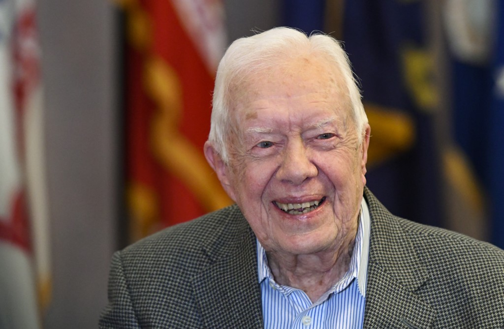 FILE - In this April 11, 2018 file photo, former President Jimmy Carter, 93, sits for an interview before a book signing in Atlanta. Carter is caution