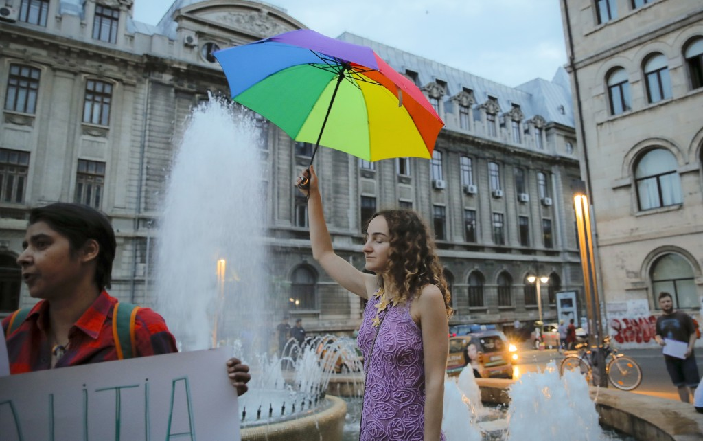 A girl takes part in a gay rights activists protest against proposed changes to the constitution that would prevent future recognition of same-sex mar