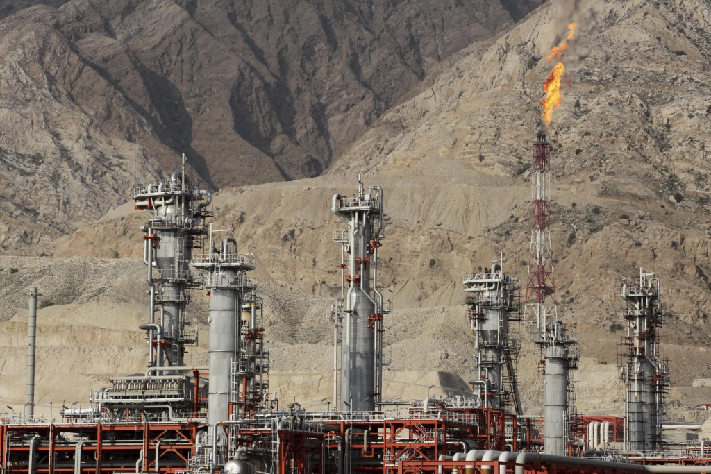 FILE - In this Jan. 22, 2014 file photo, a gas flare burns at a gas refinery in the South Pars gas field, on the northern coast of the Persian Gulf, i