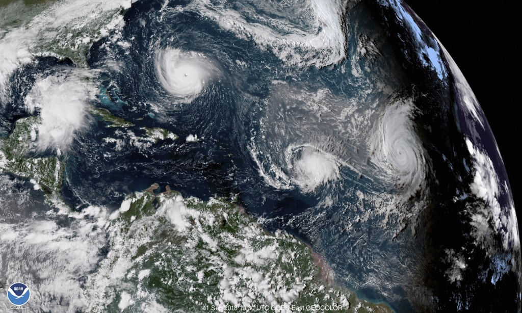CORRECTS DATE TO SEPT. 11, NOT 1 - This enhanced satellite image made available by NOAA shows Tropical Storm Florence, upper left, in the Atlantic Oce...