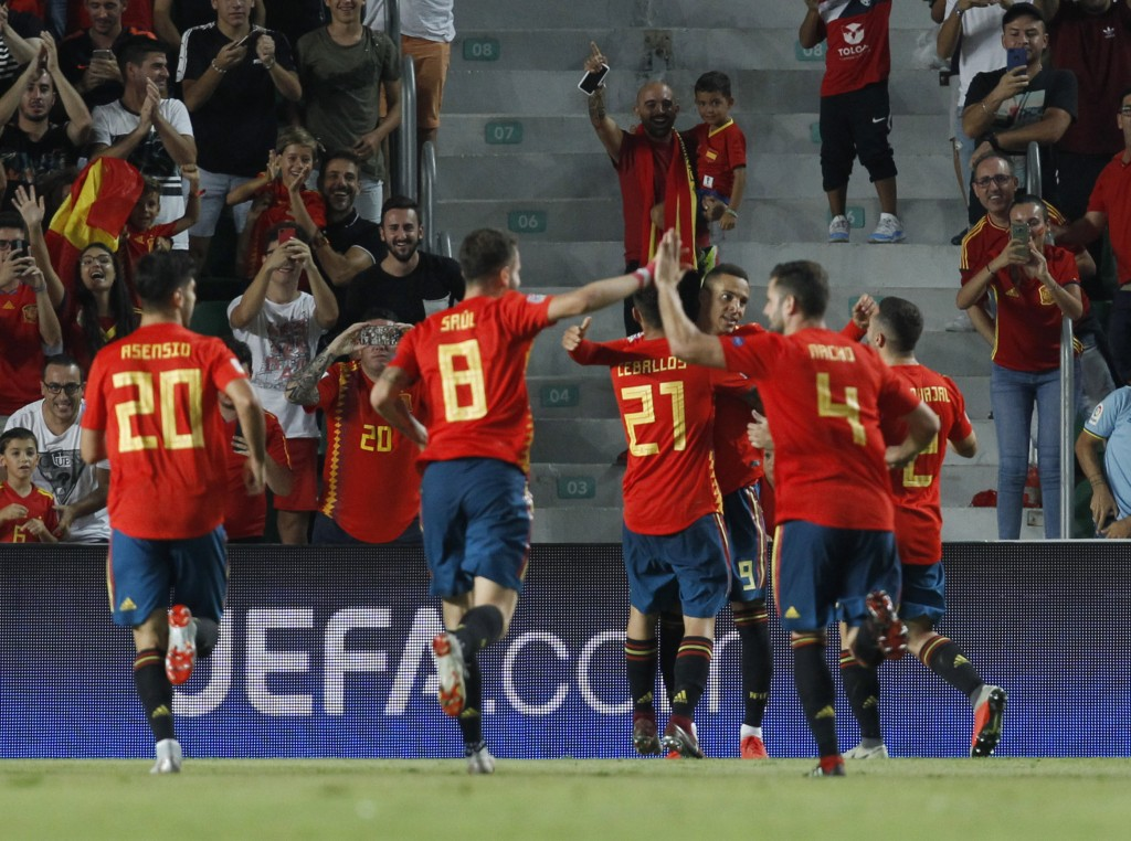Spain's Nacho Fernandez celebrates with teammates after scoring his side's fourth goal during the UEFA Nations League soccer match between Spain and C