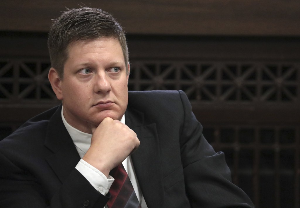 FILE - In this Thursday, Sept. 6, 2018, file photo, Chicago police Officer Jason Van Dyke, charged with first-degree murder in the shooting of black t