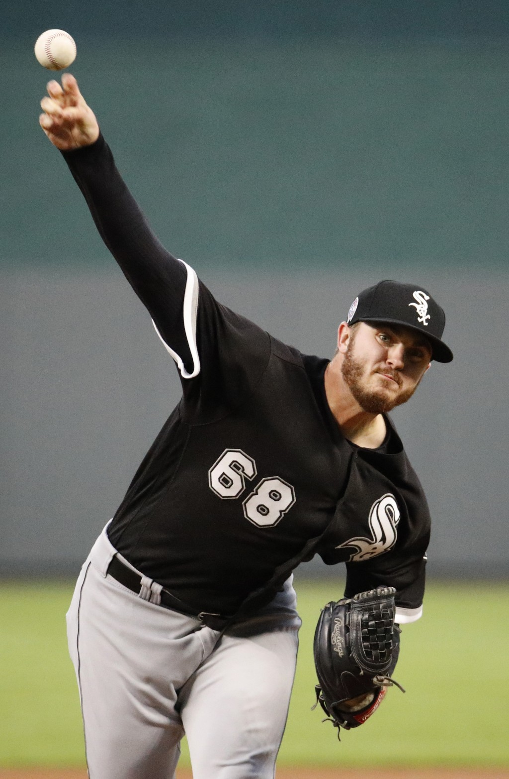 Chicago White Sox starting pitcher Dylan Covey throws during the first inning of a baseball game against the Kansas City Royals Tuesday, Sept. 11, 201