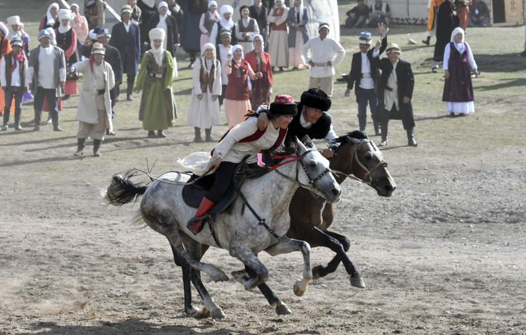 In this photo taken on Monday, Sept. 3, 2018, participants take part in a horse-riding competition, during the Third Nomad Games, in Cholpon-Ata, 250