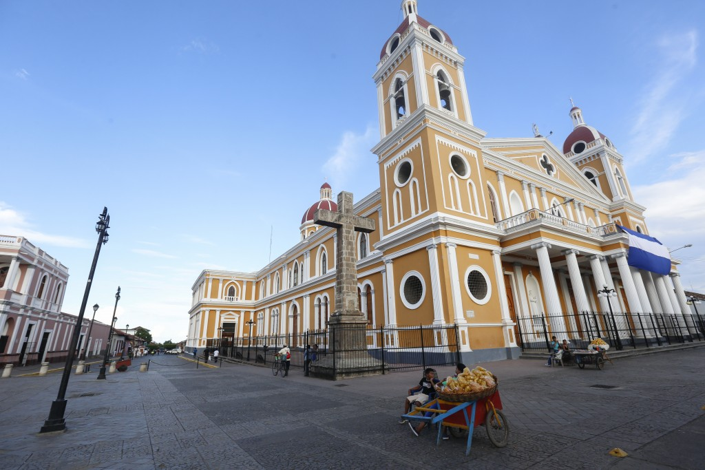 The colonial downtown of the city of Granada and its cathedral looks forlorn and empty for lack of tourists, in Nicaragua, Monday, Sept. 10, 2018. Nic