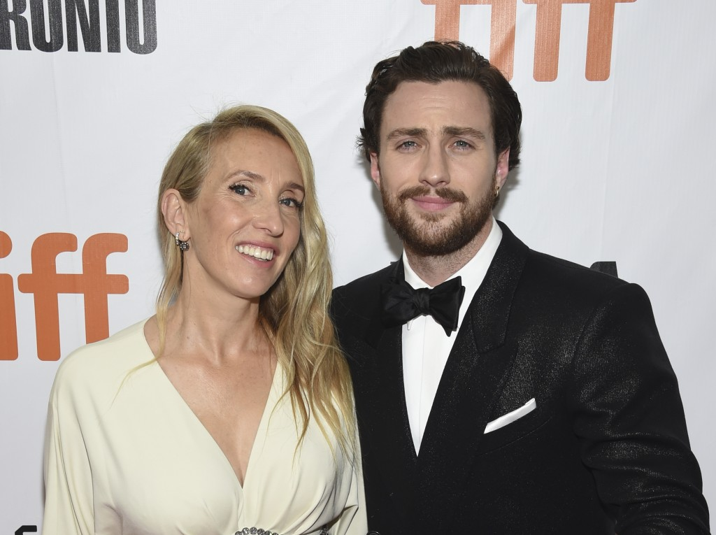 "FILE - In this Sept. 6, 2018 file photo, director Sam Taylor-Johnson, left, and her actor husband Aaron Taylor-Johnson attend the gala for ""Outlaw Kin"