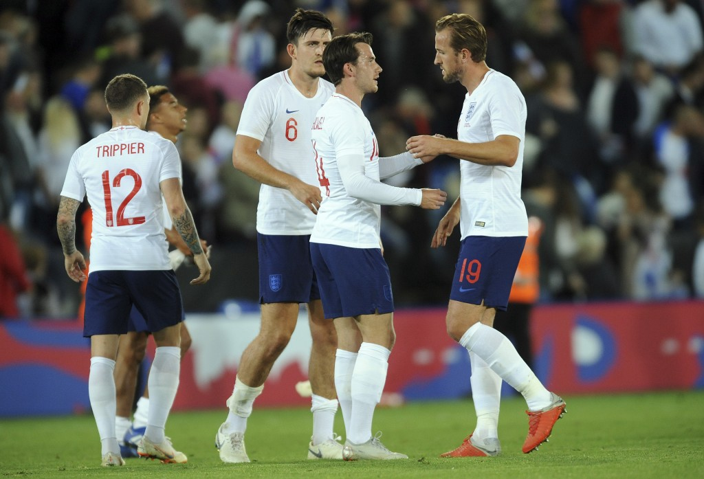 England players chat after winning the International friendly soccer match between England and Switzerland at the King Power Stadium in Leicester, Eng