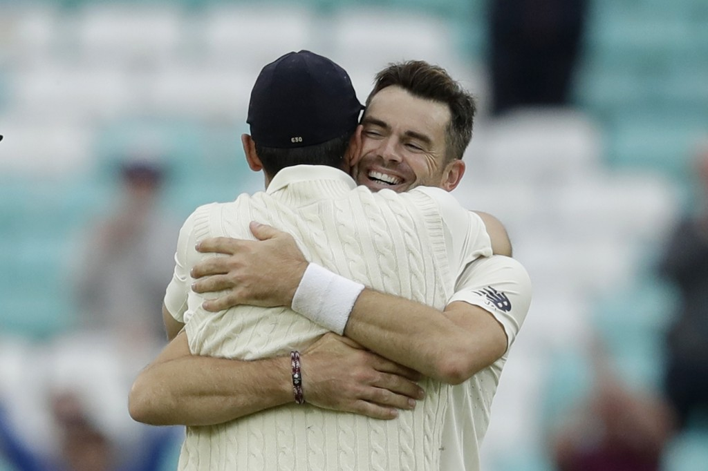 England's Jimmy Anderson, right, celebrates taking the wicket of India's Mohammed Shami for the most number of wickets ever taken by a pace bowler wit
