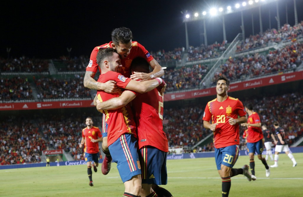 Spain's Saul Niguez, front left, celebrates with teammates after scoring his side's opening goal during the UEFA Nations League soccer match between S