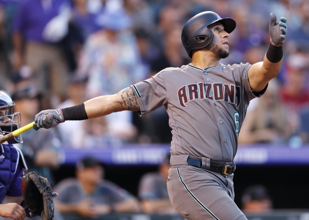 Arizona Diamondbacks' David Peralta follows the flight of his two-run home run off Colorado Rockies starting pitcher Antonio Senzatela in the first in