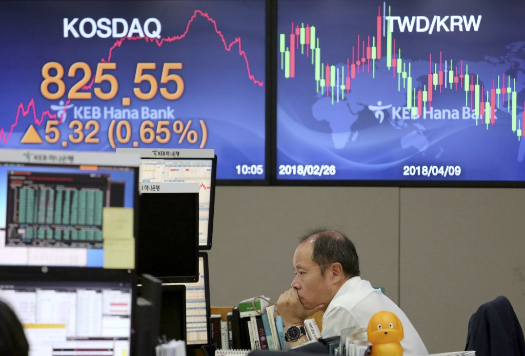 A currency trader watches monitors at the foreign exchange dealing room of the KEB Hana Bank headquarters in Seoul, South Korea, Wednesday, Sept. 12,