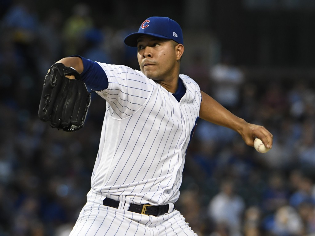 Chicago Cubs starting pitcher Jose Quintana (62) throws the ball against the Milwaukee Brewers during the first inning of a baseball game, Tuesday, Se