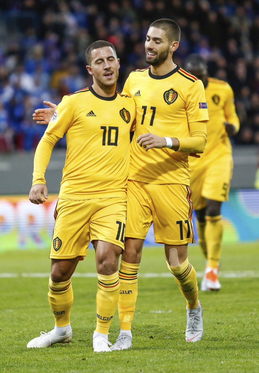 Belgium's Eden Hazard (10), left, celebrates his goal with Yannick Carrasco (11), right, during the UEFA Nations League soccer match between Iceland a