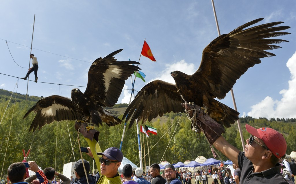 In this photo taken on Thursday, Sept. 6, 2018, participants hold golden eagles for an eagle hunt, during the Third World Nomad Games, in Cholpon-Ata,...