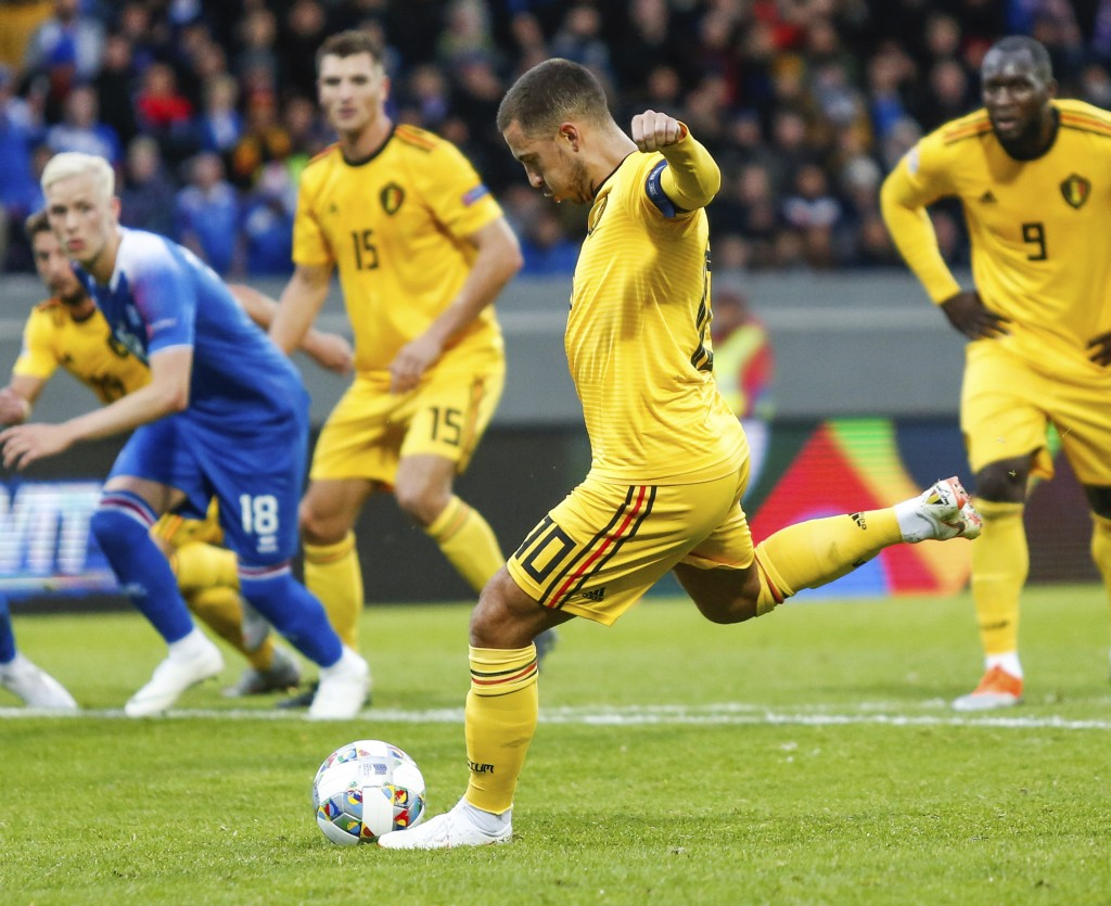 Belgum's Eden Hazard (10), right, scores from a penalty against Iceland during the UEFA Nations League soccer match between Iceland and Belgium at Lau