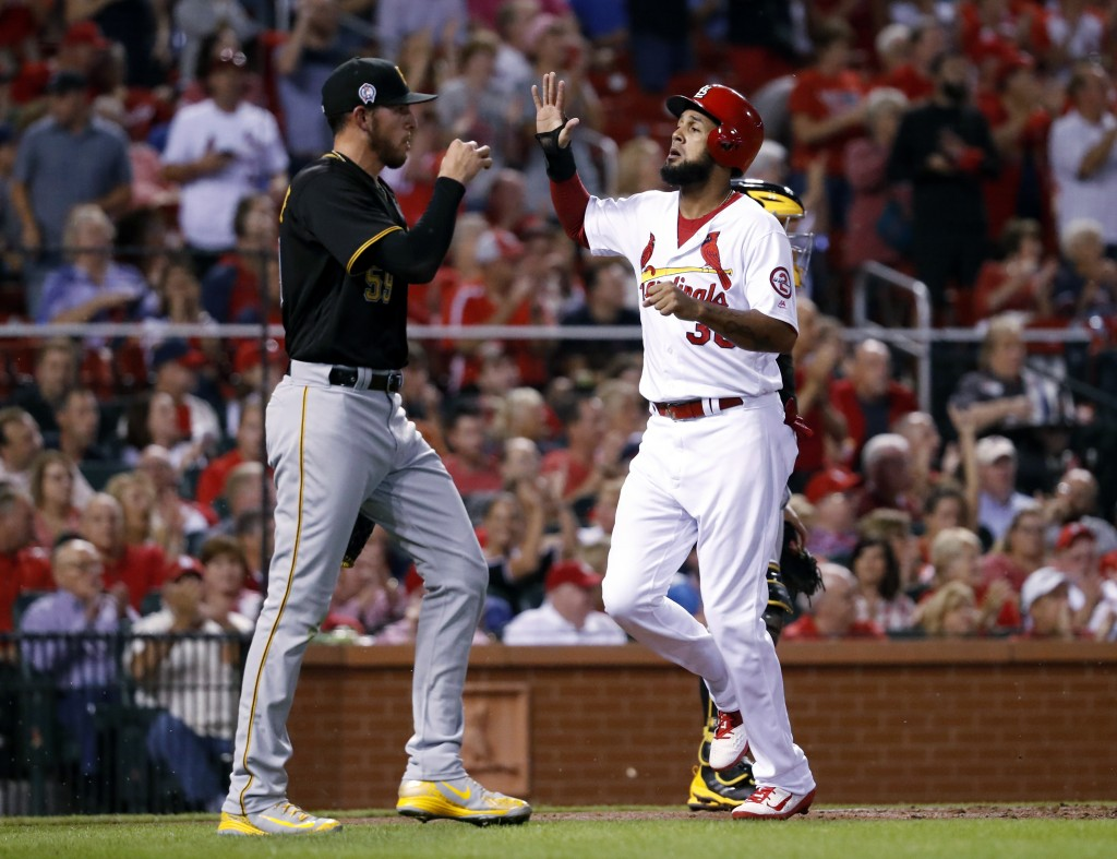 St. Louis Cardinals' Jose Martinez, right, celebrates as he scores past Pittsburgh Pirates starting pitcher Joe Musgrove during the first inning of a