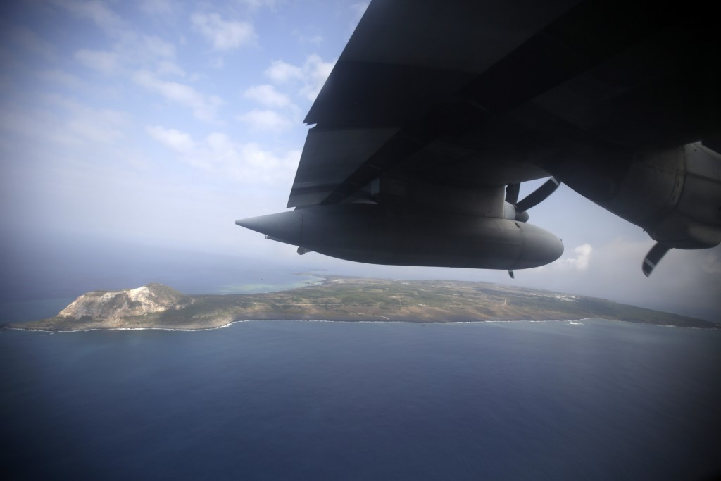 FILE - In this March 21, 2015, file photo, Iwo Jima, now known officially as Ioto, is seen from an airplane in Japan. Japan's Meteorological Agency sa...