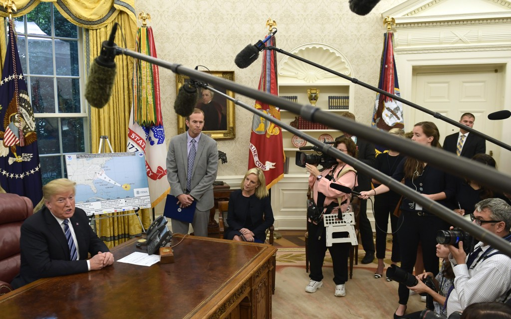 President Donald Trump, left, joined by FEMA Administrator Brock Long, second from left, and Homeland Security Secretary Kirstjen Nielsen, center, spe