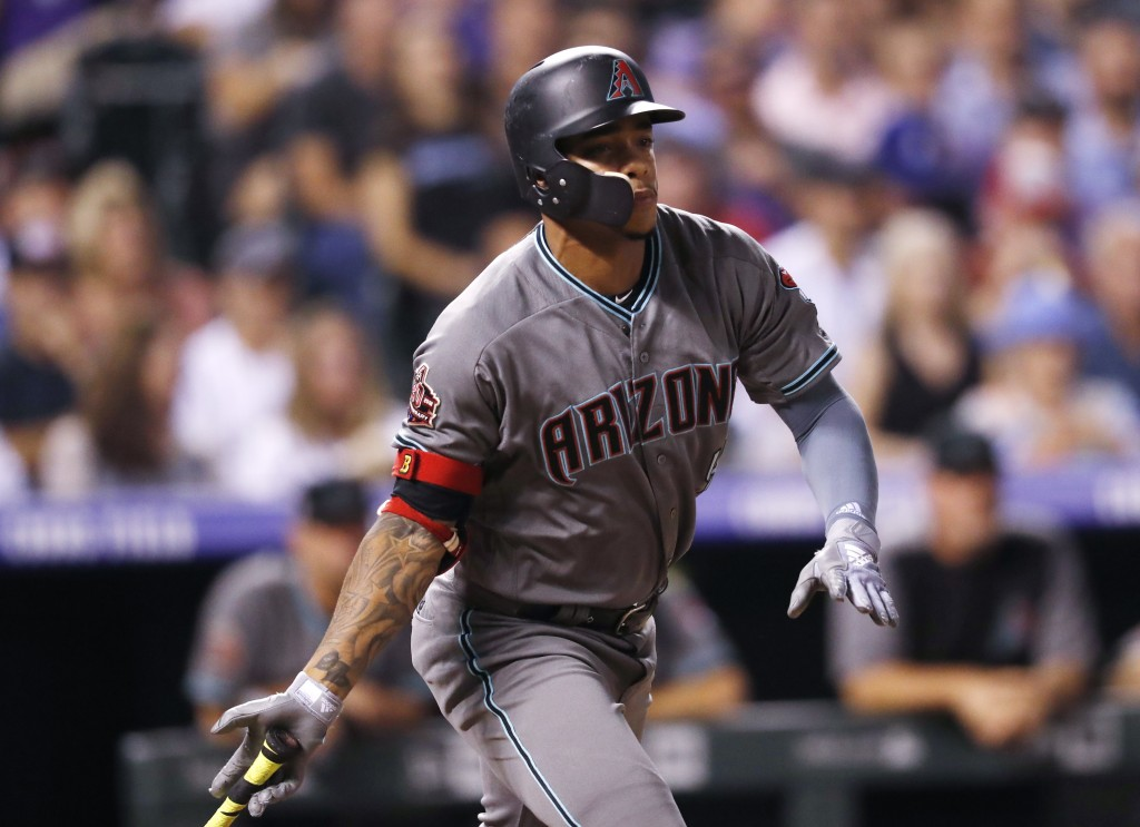 Arizona Diamondbacks' Ketel Marte follows the flight of his triple to drive in two runs off Colorado Rockies starting pitcher Antonio Senzatela in the