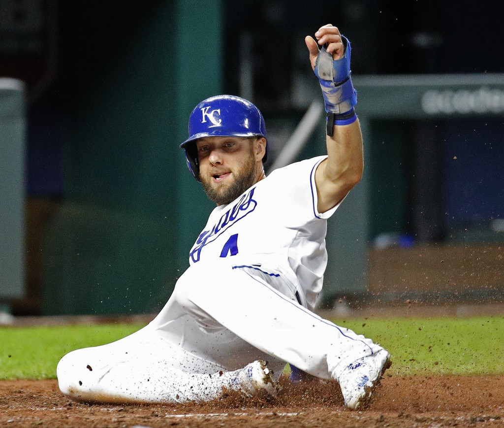 Kansas City Royals' Alex Gordon slides across the plate to score on a two-run single hit by Hunter Dozier during the fifth inning of a baseball game a