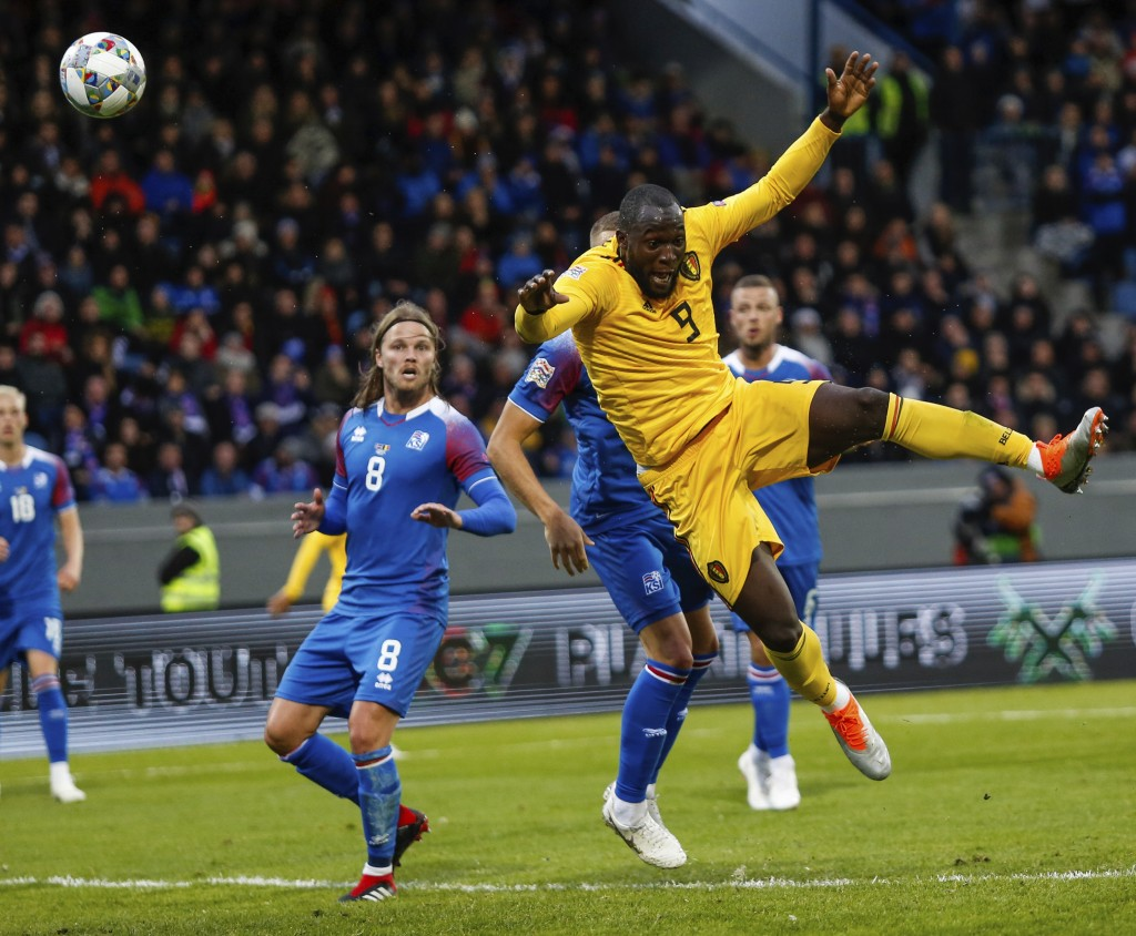 Belgum's Romelu Lukaku (9), right, wins a penalty against Iceland during the UEFA Nations League soccer match between Iceland and Belgium at Laugardal