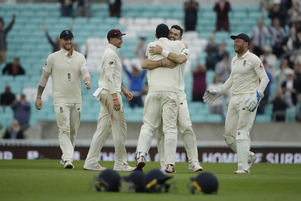 England's Jimmy Anderson, second right, celebrates taking the wicket of India's Mohammed Shami for the most number of wickets ever taken by a pace bow