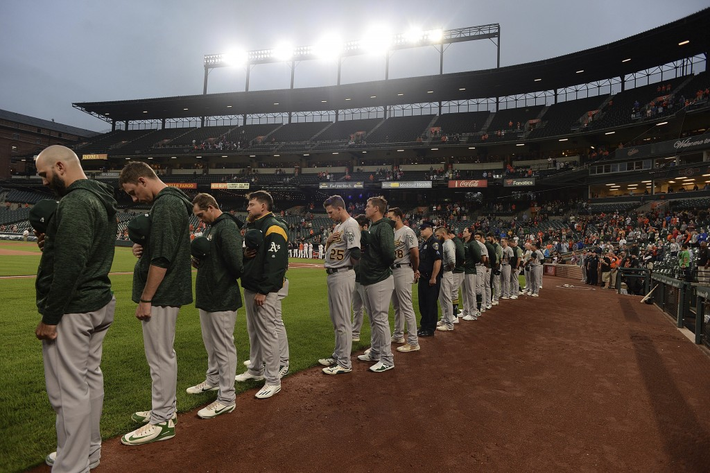 The Oakland Athletics stand for a moment of silence in remembrance of the Sept. 11th terror attacks before playing the Baltimore Orioles in a baseball