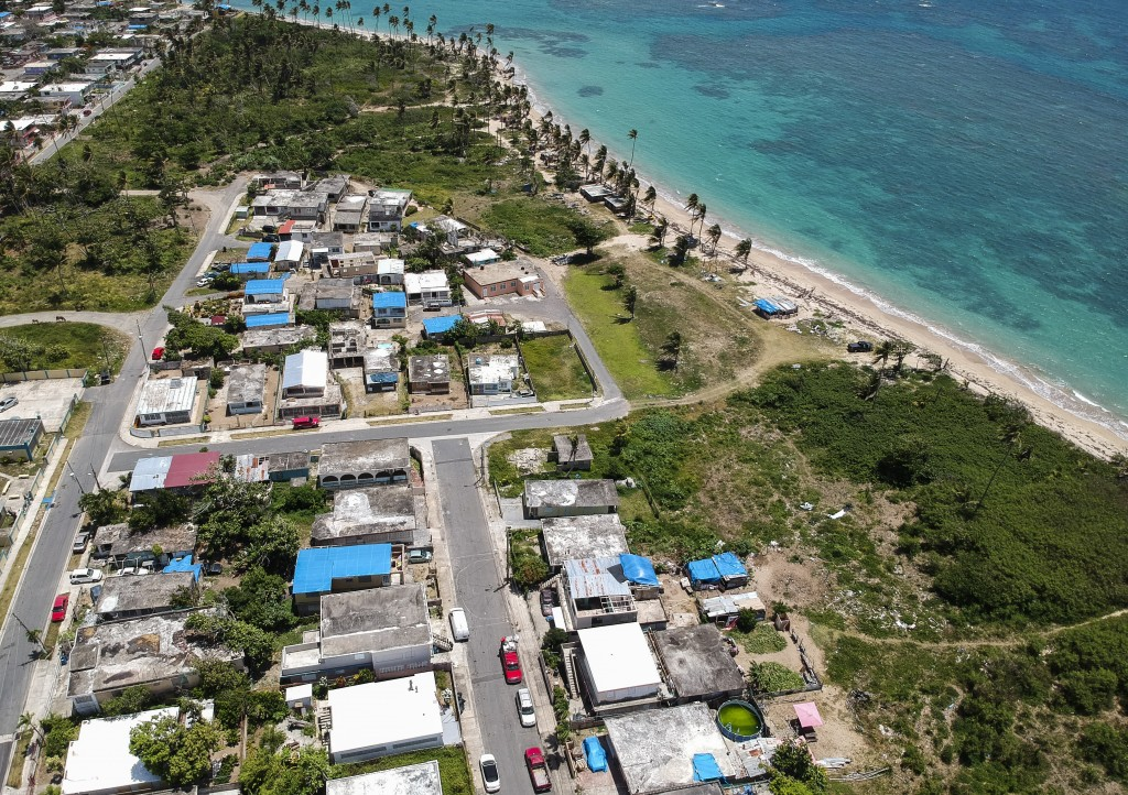 FILE - This June 18, 2018 file photo shows an aerial photo of the Viequez neighborhood, east of San Juan, Puerto Rico, where people were still living