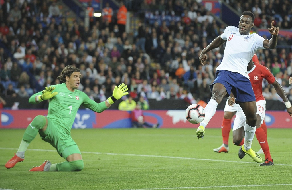 Switzerland goalkeeper Yann Sommer, left, and England's Danny Welbeck challenge for the ball during the International friendly soccer match between En