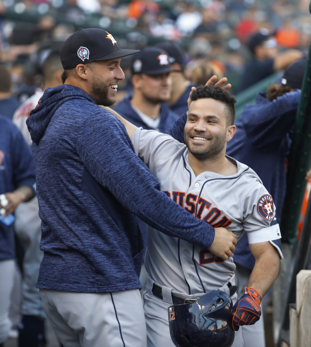 Houston Astros' Jose Altuve, right, celebrates his leadoff solo home run with George Springer in the first inning of a baseball game against the Detro