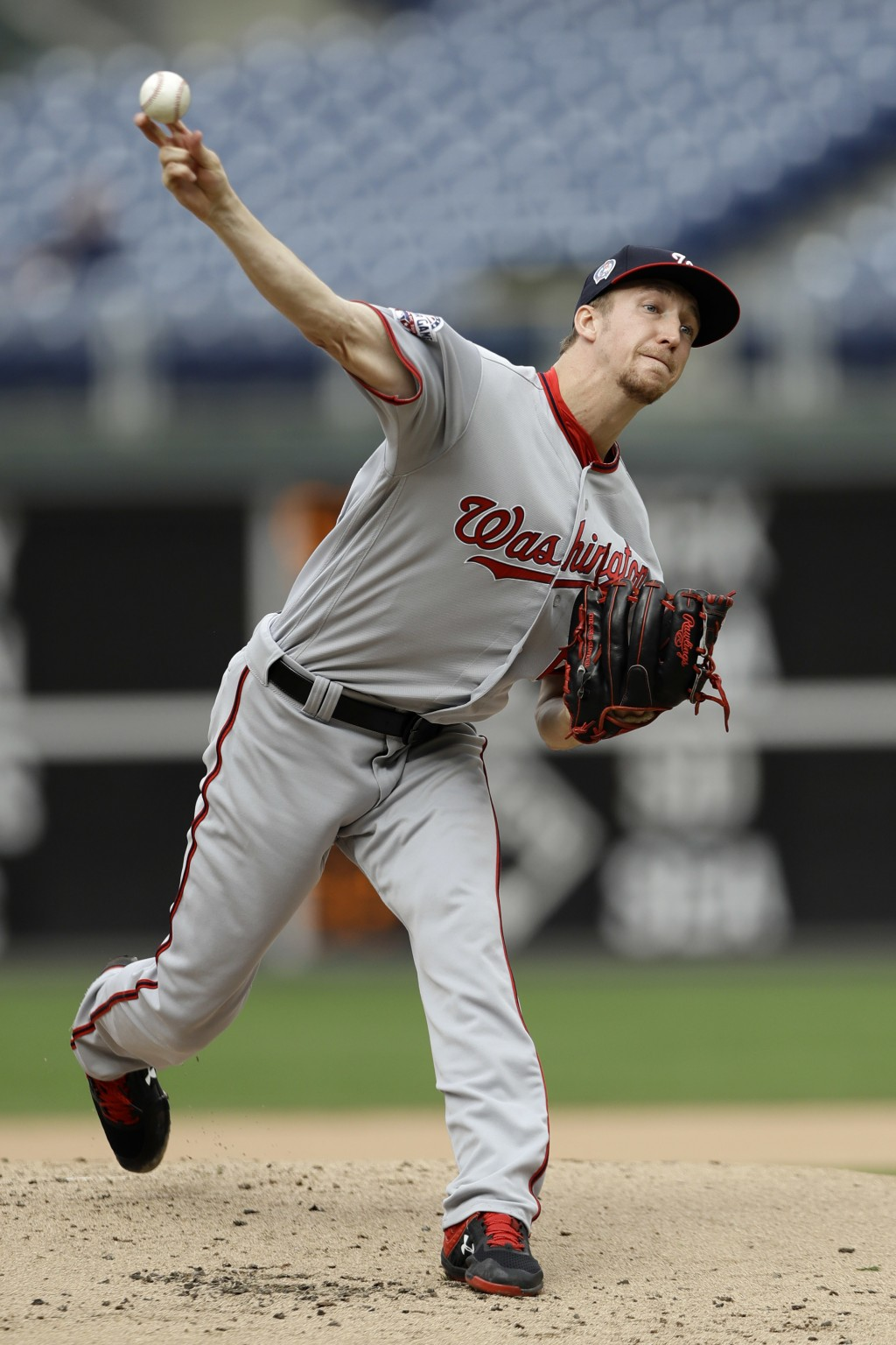 Washington Nationals' Erick Fedde pitches during the first inning of the first game of a baseball doubleheader against the Philadelphia Phillies, Tues