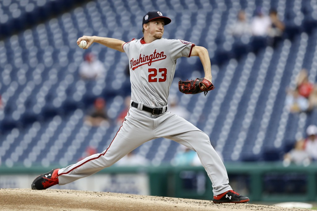 Washington Nationals' Erick Fedde pitches during the third inning of the first game of a baseball doubleheader against the Philadelphia Phillies, Tues