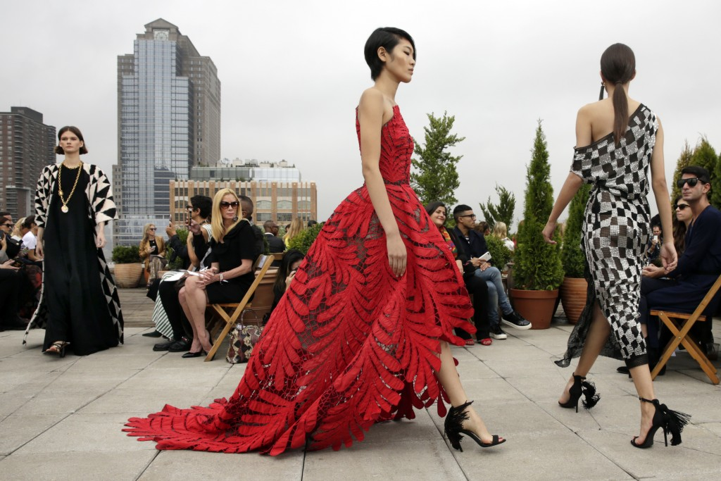 Models walk in the finale of the Oscar de la Renta spring 2019 collection during Fashion Week in New York, Tuesday, Sept. 11, 2018. (AP Photo/Richard