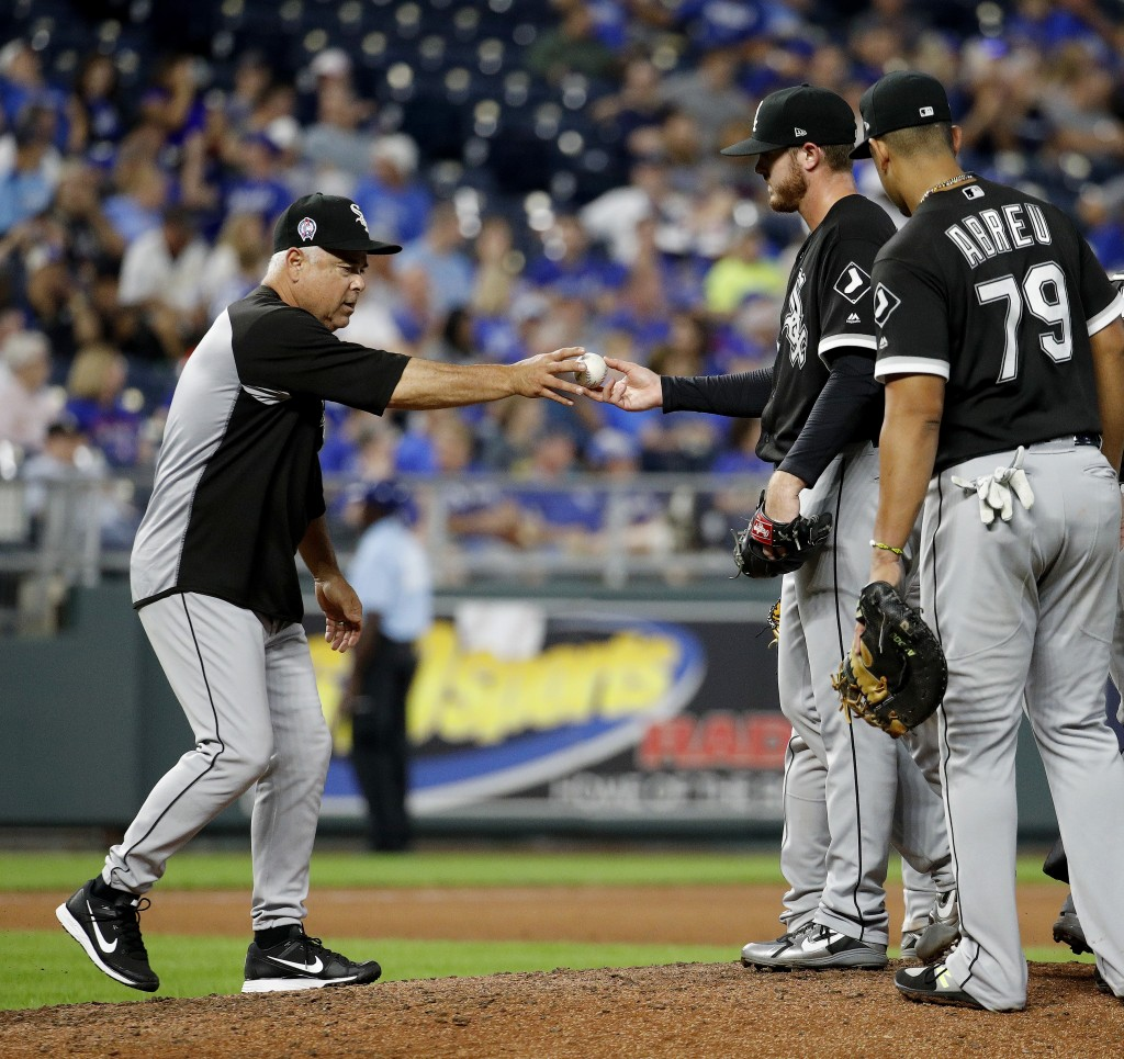 Chicago White Sox manager Rick Renteria takes the ball from starting pitcher Dylan Covey as he makes a pitching change during the fifth inning of a ba