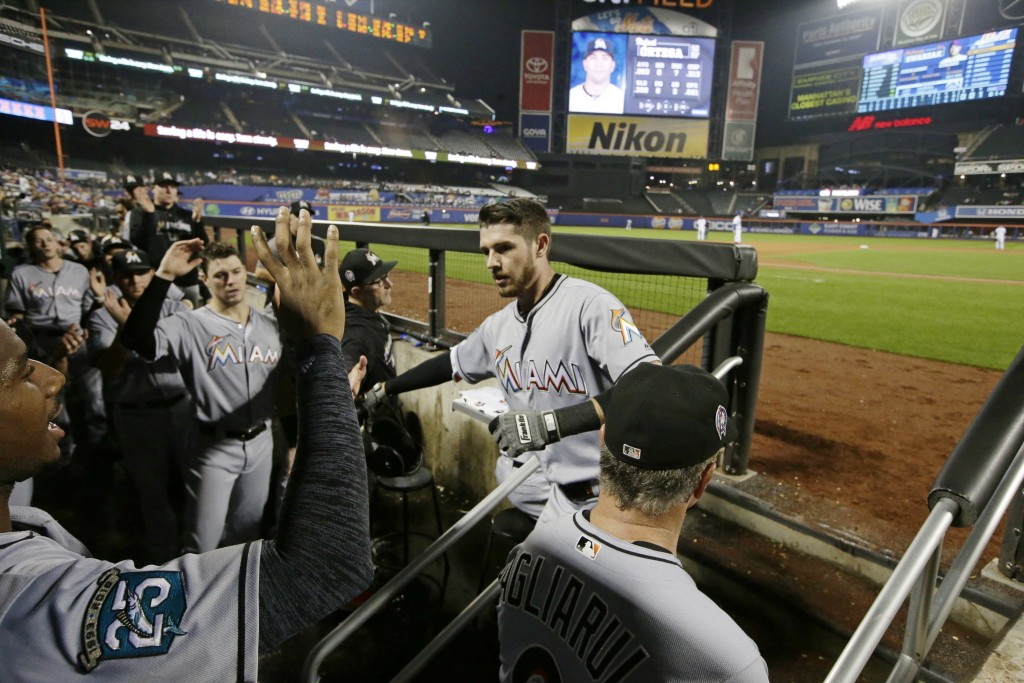 Miami Marlins' JT Riddle (10) celebrates with teammates after hitting a home run during the eighth inning of a baseball game against the New York Mets