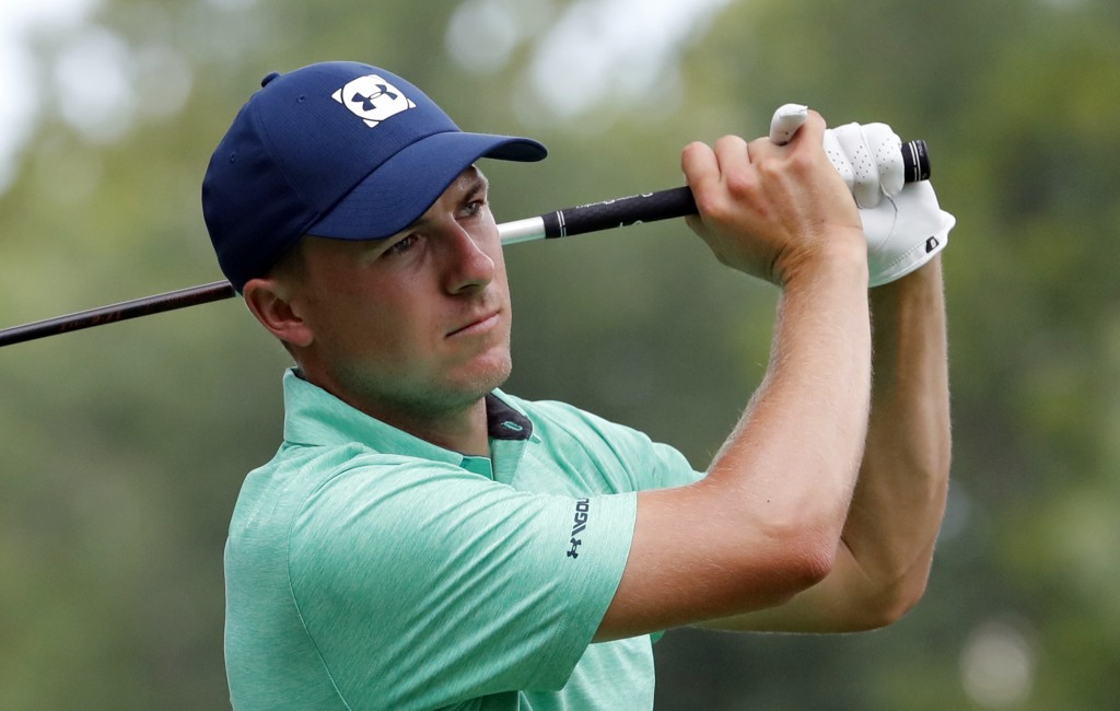 FILE - In this Aug. 8, 2018 file photo Jordan Spieth watches his tee shot on the 15th hole during a practice round for the PGA Championship golf tourn
