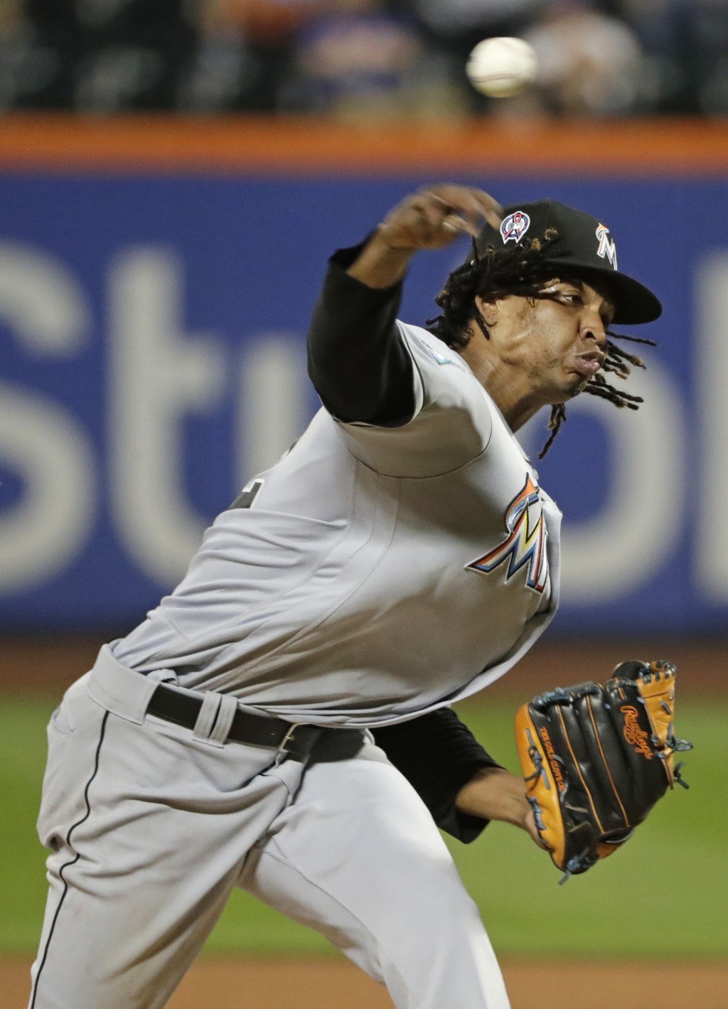 Miami Marlins' Jose Urena delivers a pitch during the fourth inning of a baseball game against the New York Mets Tuesday, Sept. 11, 2018, in New York.