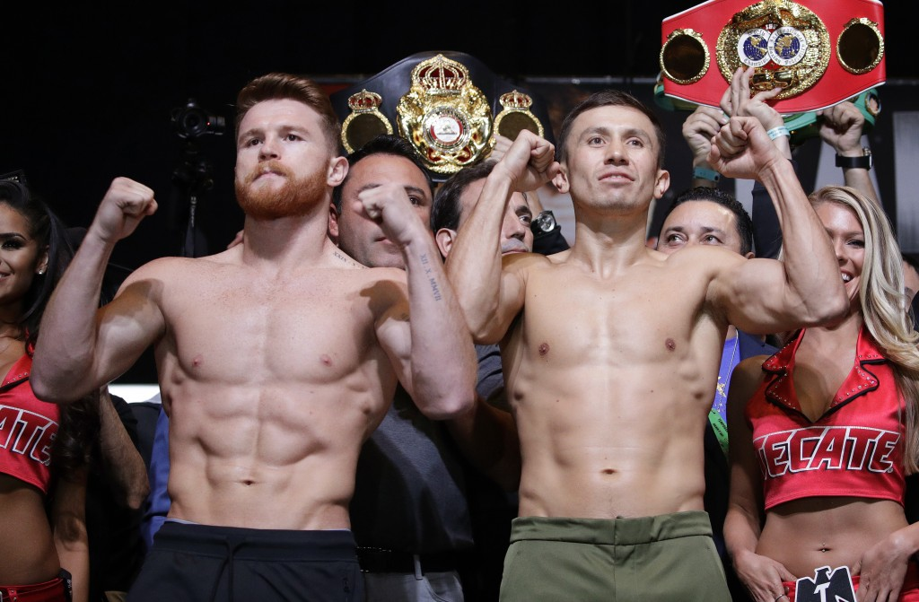 FILE - In this Sept. 15, 2017, file photo, Canelo Alvarez, left, and Gennady Golovkin pose during a weigh-in in Las Vegas. Golovkin's trainer says his