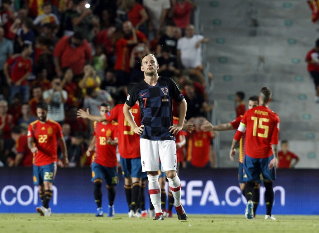 Croatia's Ivan Rakitic, center, reacts after Spain's Rodrigo Moreno scoring his side's fourth goal during the UEFA Nations League soccer match between