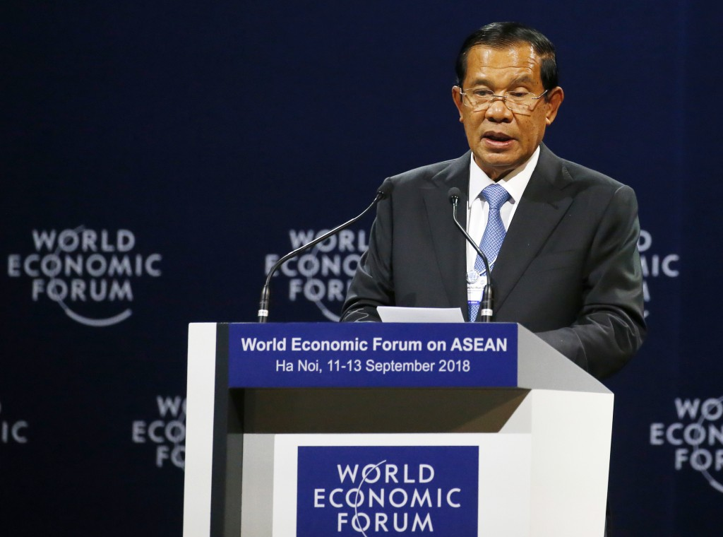 Cambodian Prime Minister Hun Sen addresses participants during the opening session of the World Economic Forum on ASEAN Wednesday, Sept. 12, 2018 in H...