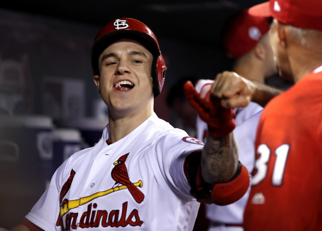 St. Louis Cardinals' Tyler O'Neill is congratulated by teammates in the dugout after hitting a three-run home run during the eighth inning of a baseba