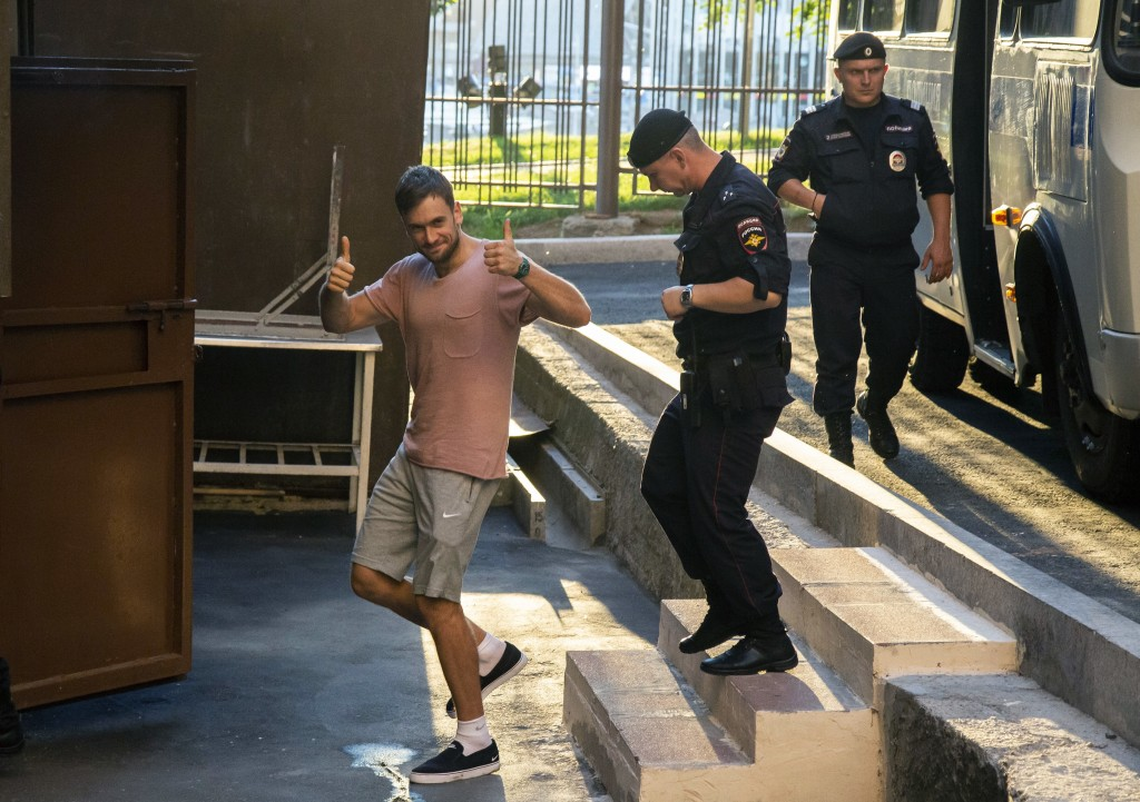 FILE. In this Tuesday, July 31, 2018 file photo, Pyotr Verzilov, a member of the feminist protest group Pussy Riot, gestures as he escorted to the cou...
