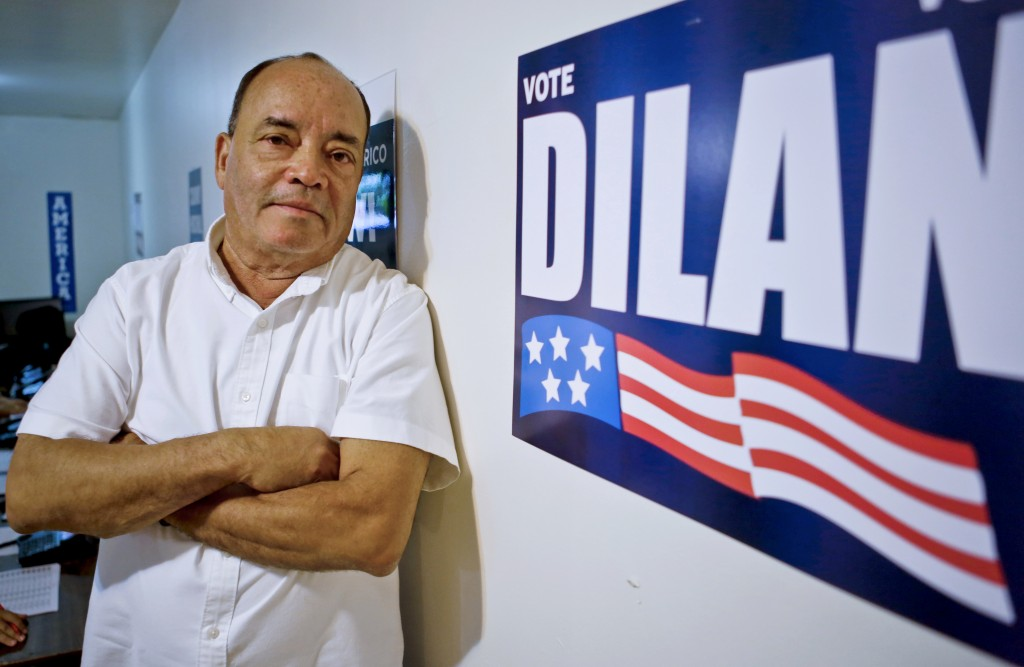 In this Aug. 30, 2018, photo, New York State Sen. Martin Dilan, a Democrat for Brooklyn's 18th senate district, pose in his campaign headquarters in N