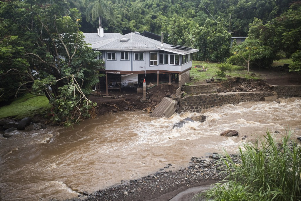 A home on Kahekili Highway near the Waihee River Bridge, was evacuated after a flash flood breached the property on Wednesday afternoon, Sept. 12, 201