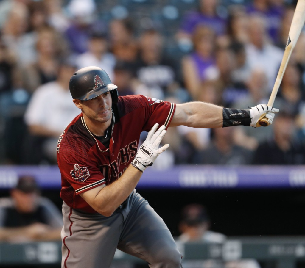 Arizona Diamondbacks' Paul Goldschmidt follows the flight of his double off Colorado Rockies starting pitcher Jon Gray in the second inning of a baseb